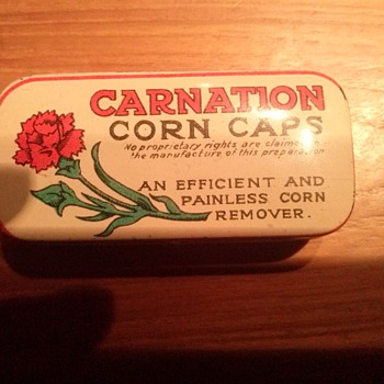 Carnation corn caps tin - Advertising
