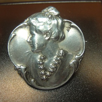 Art Nouveau woman's head brooch