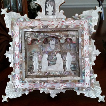 A mother of pearl three-dimensional depiction of the Nativity Scene