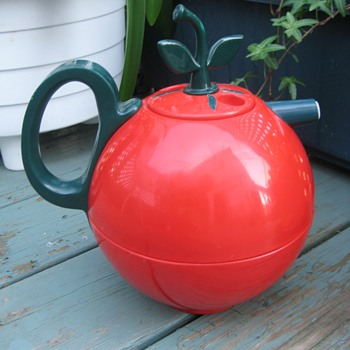 big red plastic thermos tomato