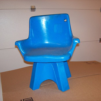 Estimated 1972 Eames style children's swivel chair