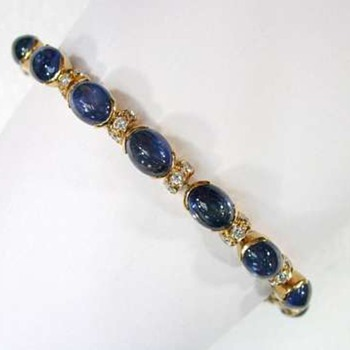 18K yellow gold diamond and sapphire cabochons bracelet.
