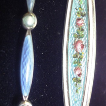 Two enameled scarf brooches/pins?