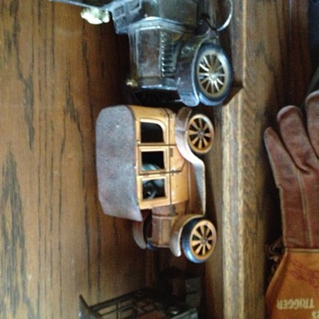 Old toy vehicles one with rear wheel lever actuated drive