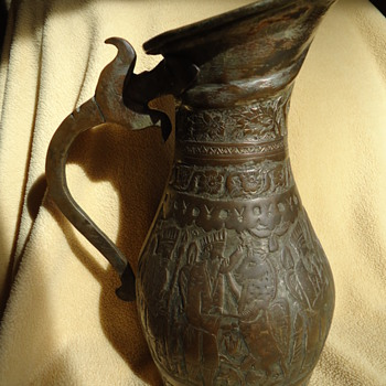 Old metal pitcher