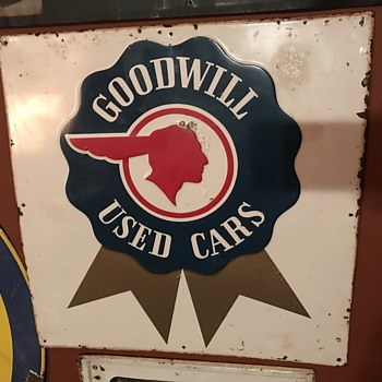 1952 GOODWILL USED CARS Pontiac tin embossed sign.