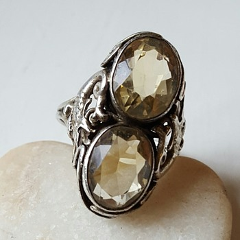 Arts and Crafts citrines double shank ring, mythical creature.