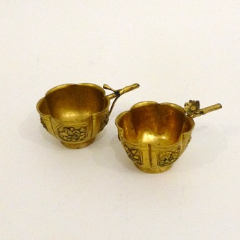 Two antique chinese fire-gilt bronze wine cups