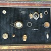 Old shadow box collection of frat pins and a portrait with other keepsakes