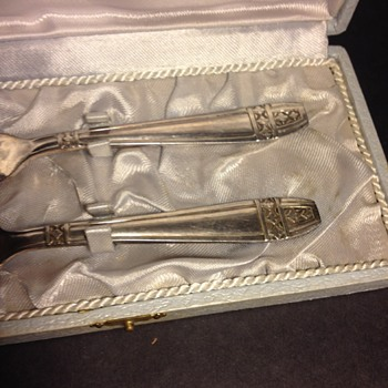Silver?  Child's fork and spoon.  Out of my league here. - Sterling Silver