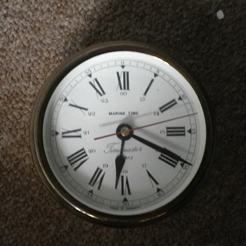 Marine Time by the German company Timemaster brass and glass in the typical round shape of a bulkhead clock