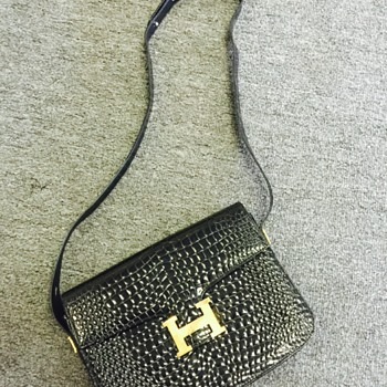 I have a vintage Hermès Constance black crocodile shoulder bag.