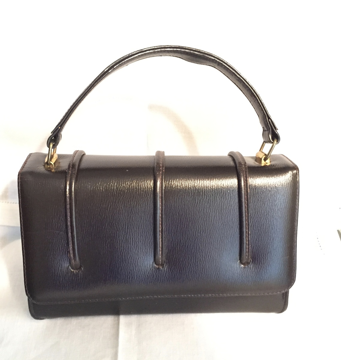 brown handbag made in canada by whom leather