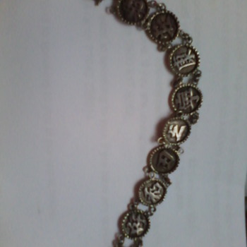 antique silver charm bracelet from my granma .