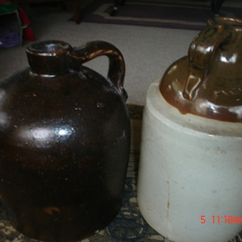 two olg gallon jugs