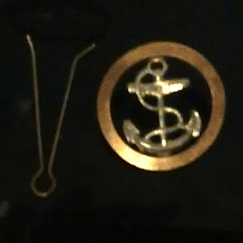 Brass and other metal pin badge, described as UK 1940's Merchant Seaman's Berrett badge?