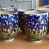 Lovely mystery cups with blue flowers