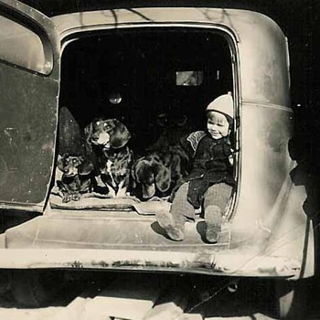 A boy and his dogs...and a cool car!