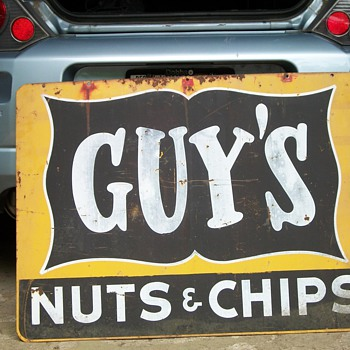 guys nut sign-used for advertising