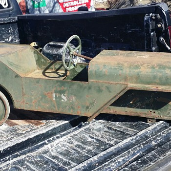 I could use some help on finding parts for this antique jeep pedal car. - Toys