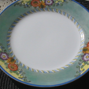 I had Bought this set Cheap any ideas 12 big plates
