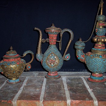 My beautiful set of Tibetan Tea Pots and a ??