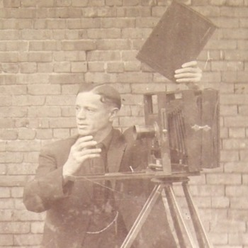 Photographer with his camera - Cameras