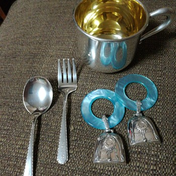 Sterling christening cup, baby spoon and fork, teething ring birth record