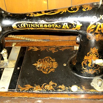 Vintage Minnesota sewing machine with cabinet