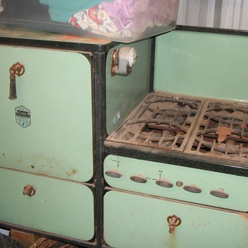Stove and oven the old turquoise color I think do not really know what color it is.  Even has the oven grades  - Kitchen