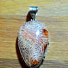 Strange stone and silver pendant