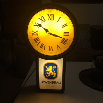 1986 Lowenbrau lighted beer sign clock.