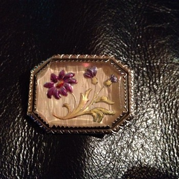 Glass overlay of jeweled flowers on Pin