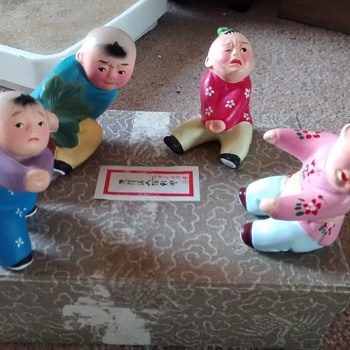 Chinese or Far east children ceramic characters boxed unhappy souls with expressive facial features - Asian