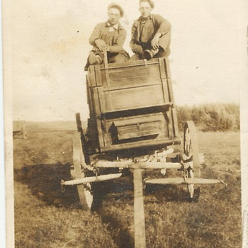 Old Family Photo . Men on a horse drawn cart