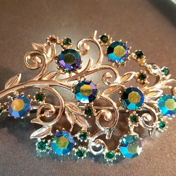 Green rhinestone and gold tone brooch