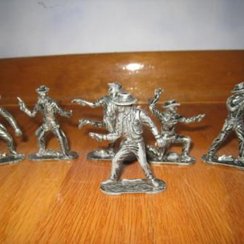 Vintage metal toy cowboys and indians figurine set