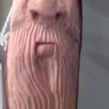 Face  carved walking stick