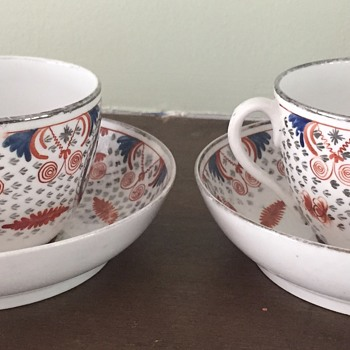 Pair of unmarked tea cups hand painted very white look old - any ideas?
