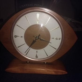 My Oval Rugby Ball shaped Westclox mantelclock clockwork wood, brass and other material.