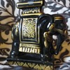Black and gold painted elephant
