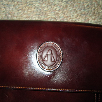 Mystery designer logo purse