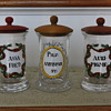 Set of three  handpainted Apotheycary jars Marked with letter M