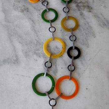 Bakelite rings with belt hardware given new life as a necklace