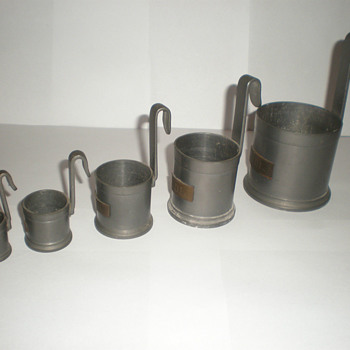 Old Dutch pewter measuring cups.