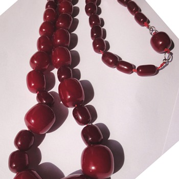 Large, vintage,  Art Deco Era, genuine cherry amber Bakelite bead necklace.