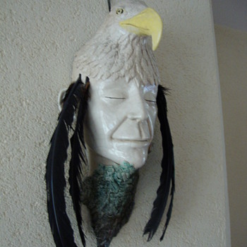 mask of an eagle topped man - Pottery