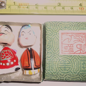 Silly! Not worth $2.00! I am going downhill!  Two mini Chinese two-faced ceramic bobble heads!!