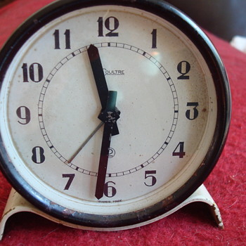 old Le Coultre clockwork alarm clock.