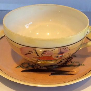 Antique Japanese tea cup and saucer
